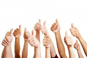 Many people congratulate a winner and holding their thumbs up